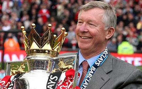 Sir Alex Ferguson celebrates with the Premier League trophy