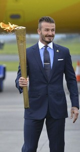 London 2012 Olympic Games ambassador David Beckham carries the Olympic torch after arriving at RNAS Culdrose base near Helston in Cornwall
