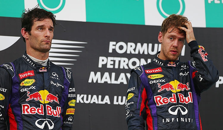 Mark Webber and Sebastian Vettel share an unhappy podium at the Malaysian Grand Prix