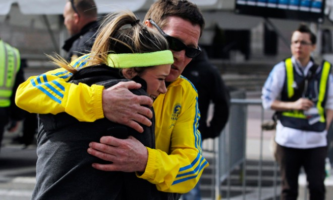A female Boston Marathon runner is comforted after the bombings