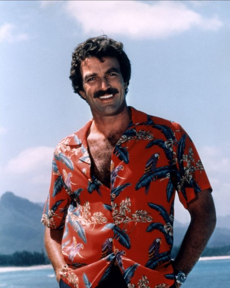Selleck dece rocks a Hawaiian shirt.