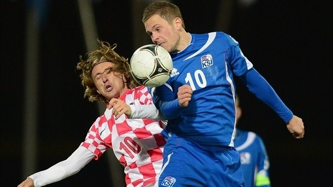 Iceland's Gylfi Sigurdsson competes for the ball with Luka Modric of Croatia.