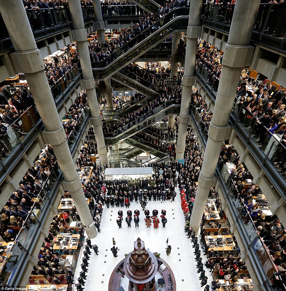 Workers at Lloyds of London stop work and gather on the balconies at 11am to observe the 2 minute silence on Monday 11th November.