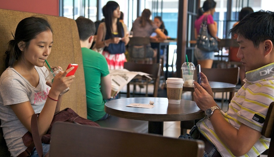 People on their phones in Starbucks