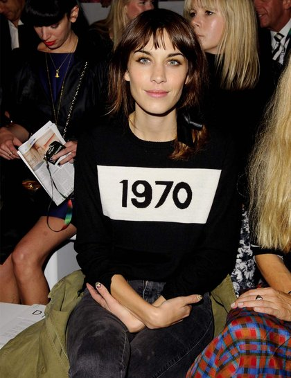 Alexa Chung wearing a Bella Freud knitted sweater front row at the Simone Rocha show during London Fashion Week