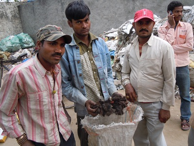 Rubbish pickers from poor impoverished areas making money by collecting peoples hair from the waste